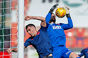 Aaron Hughes of Heart of Midlothian challenges goalkeeper Gary Woods of Hamilton Academical FC during the Ladbrokes Scottish Premiership League match between Hamilton Academical FC and Heart of Midlothian FC at New Douglas Park, Hamilton, Scotland on 4 August 2018. Picture by Malcolm Mackenzie.