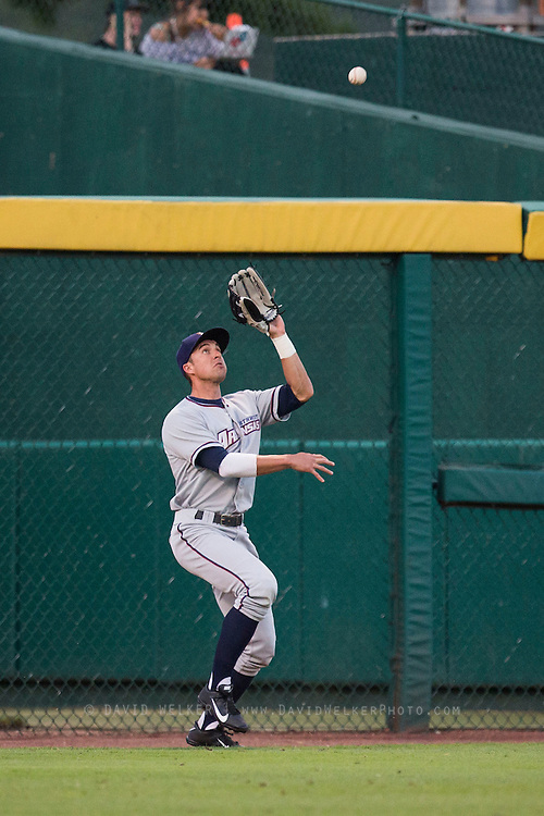 Lane Adams (8) of the Northwest Arkansas Naturals catches a ball in left field during a game against the Springfield Cardinals at Hammons Field on August 20, 2013 in Springfield, Missouri. (David Welker)