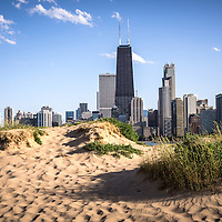 Picture of Chicago beach and Chicago skyline at North Avenue Beach with the Hancock building. The John Hancock Center building is one of the world's tallest skyscrapers and is a famous fixture in the Chicago skyline. Photo is high resolution and was taken in 2012.