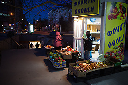 Crimea one day before the referendum. A fruit vendor waits fro costumers in the streets of Simferopol at dusk. Simferopol, . Saturday, 15th March 2014. Picture by Daniel Leal-Olivas / i-Images