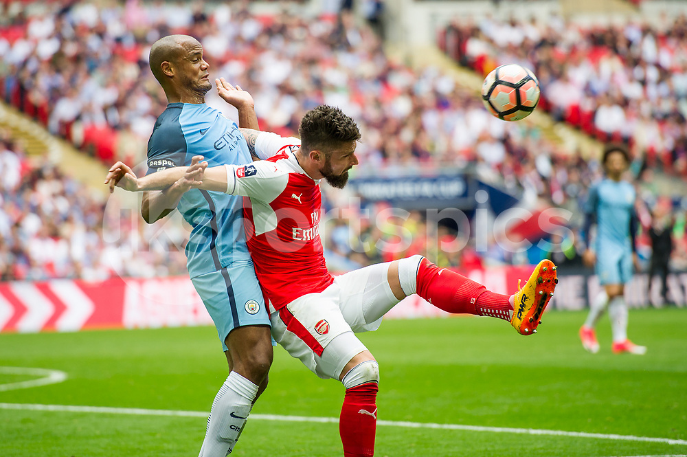 Vincent Kompany of Manchester City and Olivier Giroud of Arsenal during the The FA Cup Semi Final match between Arsenal and Manchester City at Wembley Stadium, London, England on 23 April 2017. Photo by Salvio Calabrese.