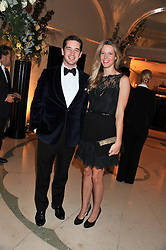 The HON.JAMES TOLLEMACHE and OLIVIA HUNT at a dinner and dance hosted by Leon Max for the charity Too Many Women in support of Breakthrough Breast Cancer held at Claridges, Brook Street, London on 1st December 2011.