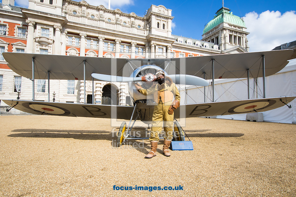 Vernon Creek of the Royal Air Force Museum poses in a period flight suit in front of a 1918 Sopwith Snipe as the Royal Air Force Museum promotes the forthcoming 100th anniversary of the Royal Air Force in 2018 with a static display of warplanes in Horseguards Parade, Westminster.<br /> Picture by Paul Davey/Focus Images Ltd +447966 016296<br /> 31/03/2016