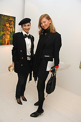 Left to right, stylist HANNAH BHUIYA and  ELIZABETH VON GUTTMAN at an exhibition of paintings by artist Rene Richard at the Scream Gallery, Bruton Street, London on 3rd April 2008.<br />