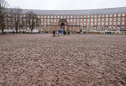 © Licensed to London News Pictures. 28/02/2020. Bristol, UK. The scene on College Green, with the grass turned to mud, after environmental activist Greta Thunberg attended the rally and march at the Bristol Youth Strike 4 Climate with many thousands of people marching through the city centre. Greta Thunberg started the Youth Strike 4 Climate protest movement in her home country of Sweden when she sat alone outside the Swedish parliament, eventually paving the way for the Fridays for Future movement across the world. Thousands of people are expected to attend the event in Bristol with many roads closed in the city centre. In 2018 Bristol was the first city to declare a climate emergency and also the first to declare an ecological emergency just four weeks ago. Photo credit: Simon Chapman/LNP.
