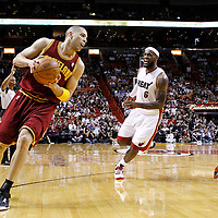 24 January 2012: Cleveland Cavaliers shooting guard Anthony Parker (18) drives past Miami Heat small forward LeBron James (6) during the Miami Heat 92-85 victory over the Cleveland Cavaliers at the AmericanAirlines Arena, Miami, Florida, USA.