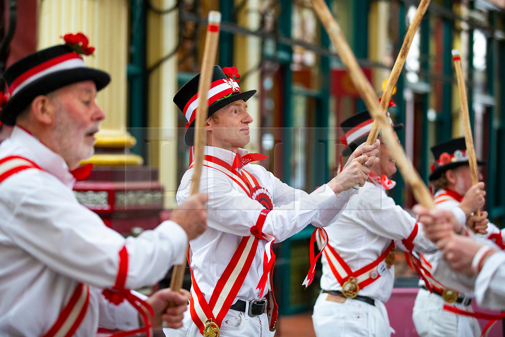 © Licensed to London News Pictures. 23/04/2018. London, UK. The Ewell St Mary's Morris Men perform at a St George's Day celebration in Leadenhall Market. Photo credit: Rob Pinney/LNP