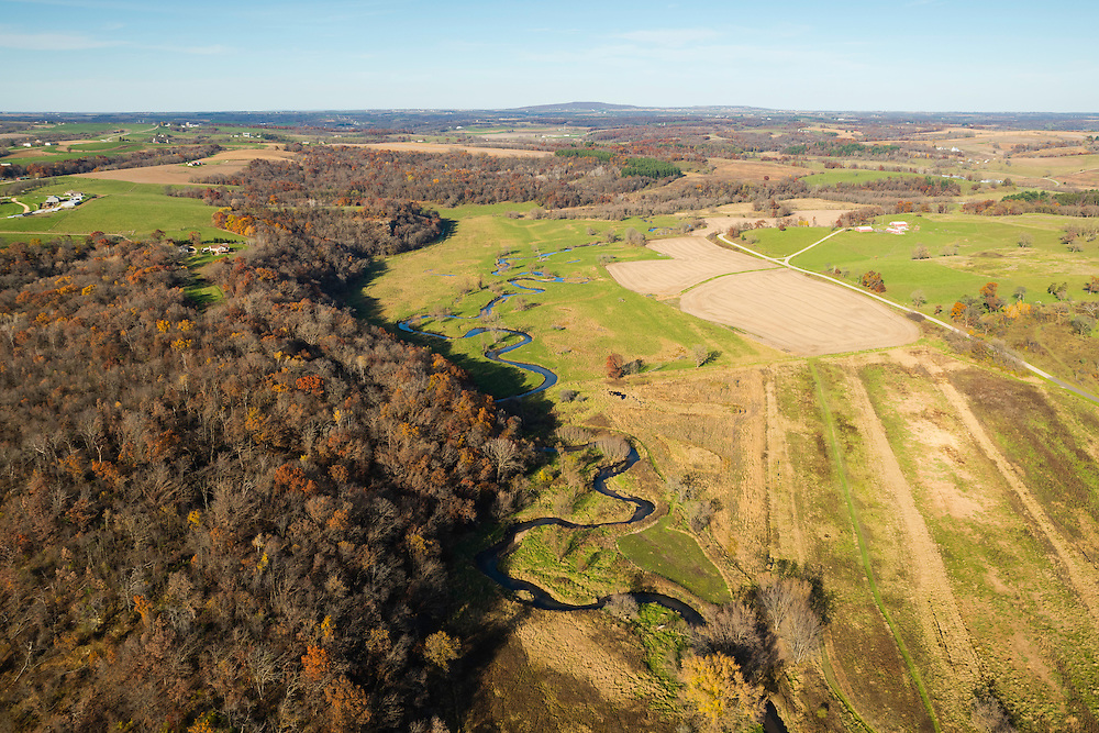 Aerial photograph of rural Wisconsin on a beautiful autumn day. Blue Mound State Park is on the horizon.