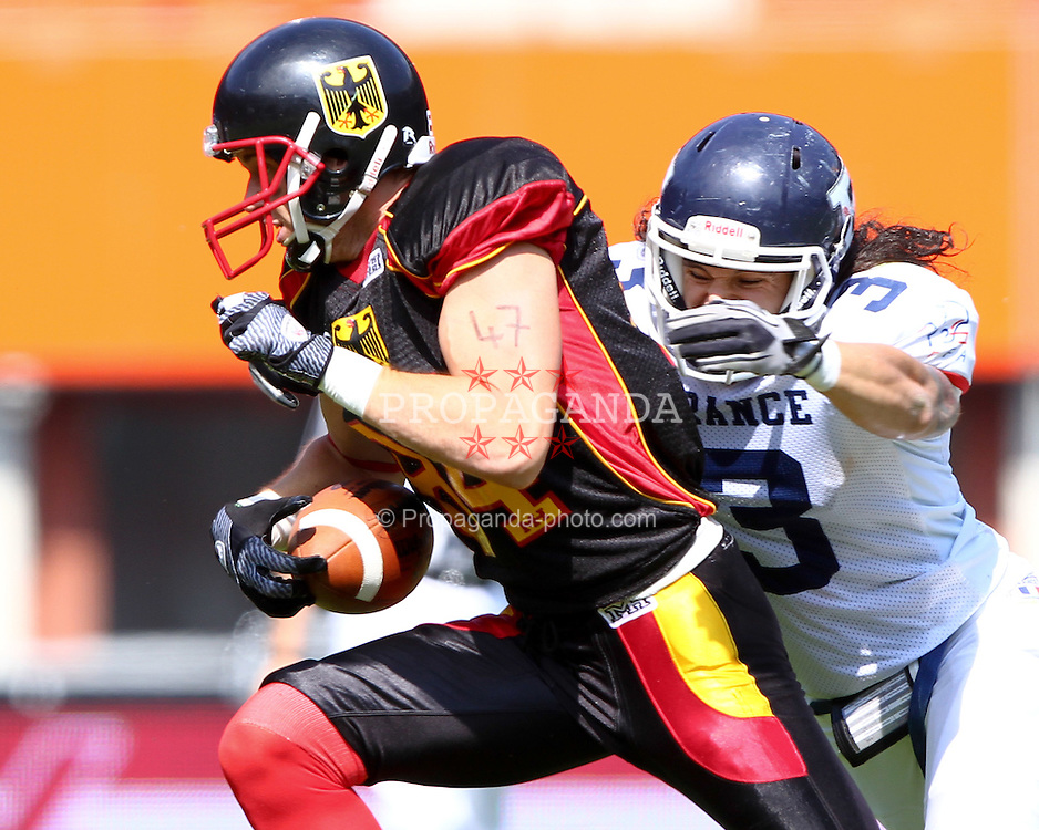 16.07.2011, Ernst Happel Stadion, Wien, AUT, American Football WM 2011, Germany (GER) vs France (FRA), im Bild Arnaud Vidaller (France, #3, DB ) catches Niklas Römer (Germany, #84, WR)  // during the American Football World Championship 2011 game, Germany vs France, at Ernst Happel Stadion, Wien, 2011-07-16, EXPA Pictures © 2011, PhotoCredit: EXPA/ T. Haumer