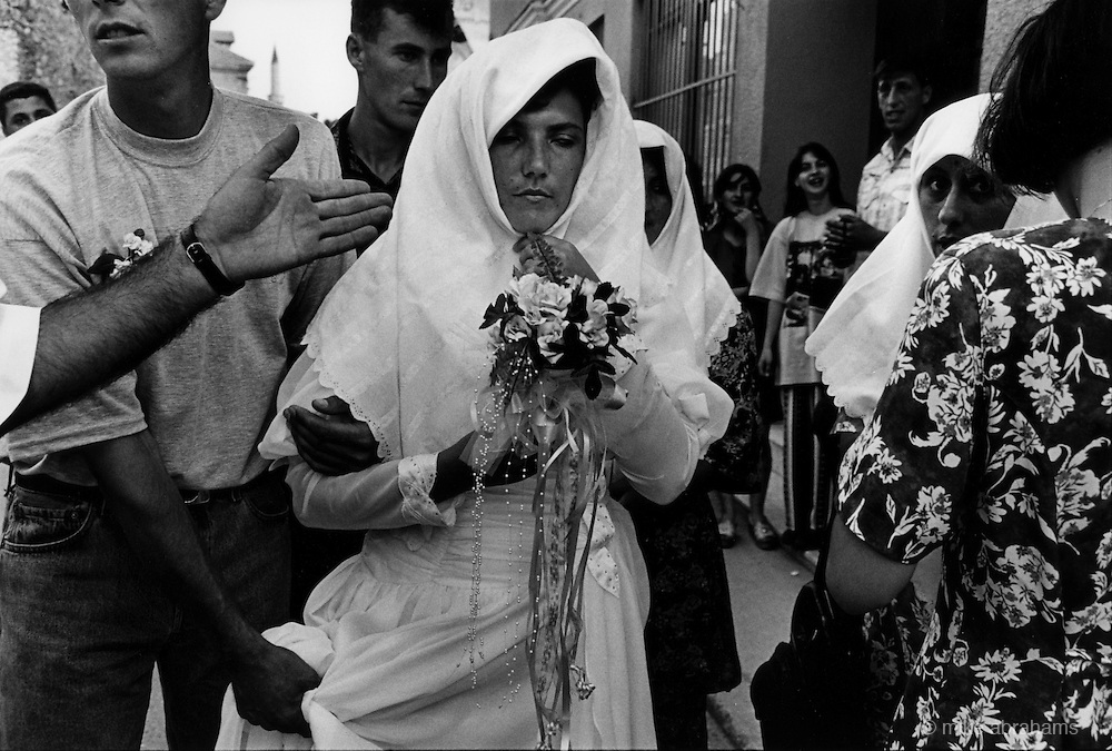 "Wedding in Muslim East Mostar as life returns to normal after the Dayton Peace Accords.  It wasdestroyed by systemic bombardment from Croat guns during the Croat Muslim War, when the Croats endeavored to "" cleanse"" the town of non Croats."