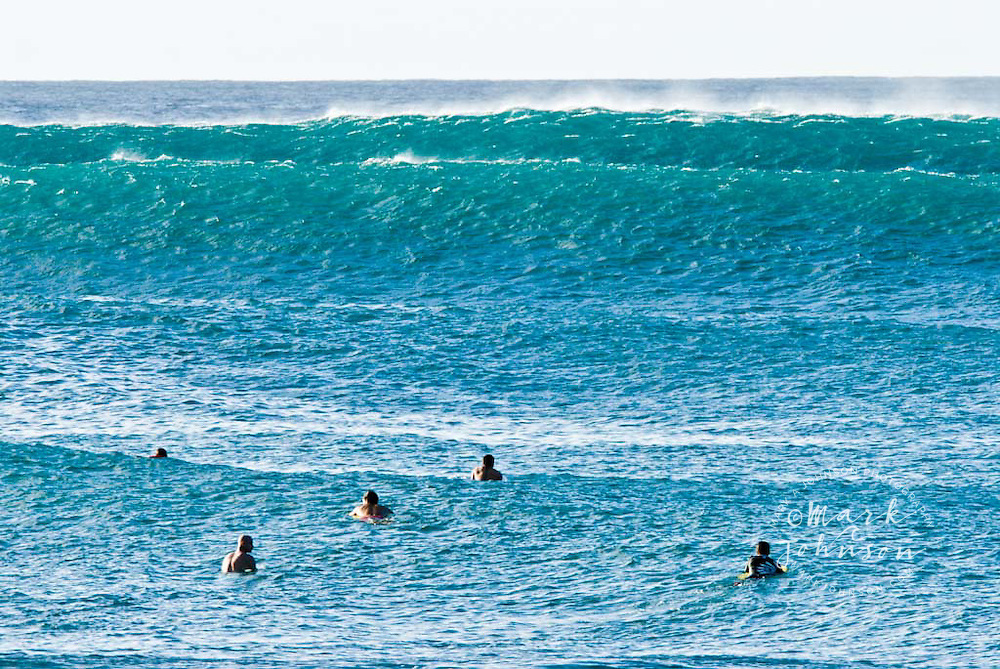 Big set breaking outside the waiting surfers at Pipeline, North Shore, Oahu, Hawaii
