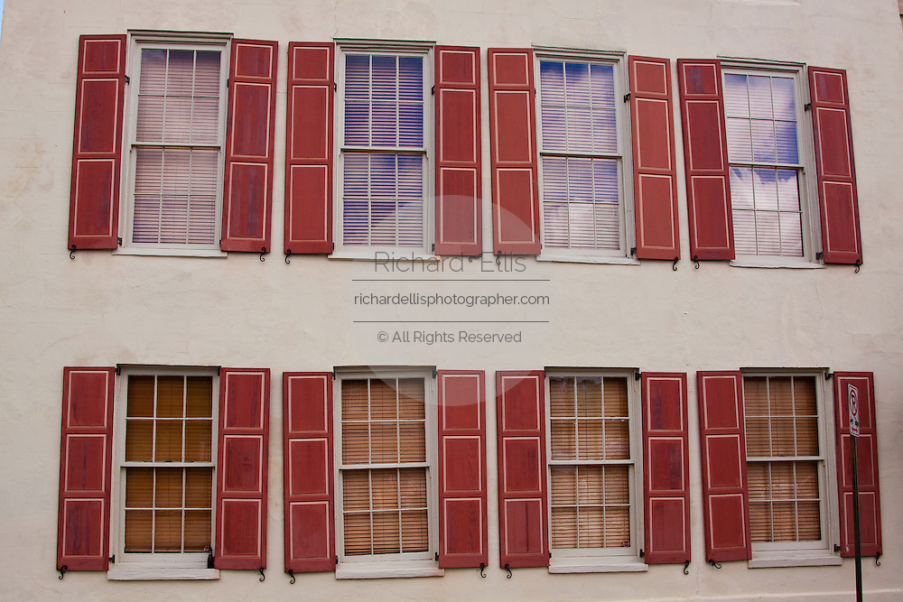 Row of identical windows along Rainbow Row in the historic Battery section of Charleston, South Carolina.
