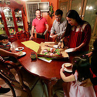 Thomas Wells | BUY AT PHOTOS.DJOURNAL.COM<br /> Alejandra Acosta, 10, from left, Luis, 3, Higinio, Cristian, 19, Luz Elena, Daniela, 18 months and Maria begin to annual tradition of eating the Rosca De Reyes at their home in Tupelo.