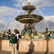 Man photographing Fountain at Place de la Concorde Paris France<br />