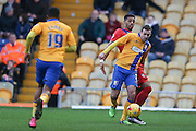 Mansfield Town defender, on loan from Notts County, Blair Adams and York City forward Vadaine Oliver  during the Sky Bet League 2 match between Mansfield Town and York City at the One Call Stadium, Mansfield, England on 28 December 2015. Photo by Simon Davies.