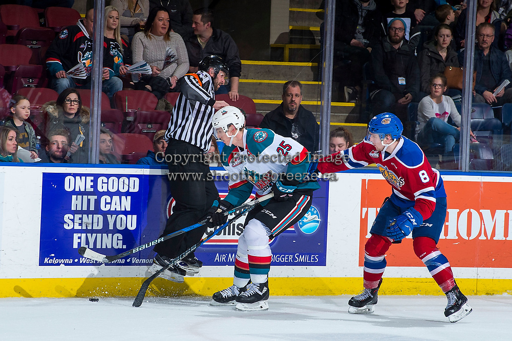 KELOWNA, CANADA - FEBRUARY 17: Referee Reagan Vetter jumps up to avoid the puck as Cal Foote #25 of the Kelowna Rockets is back checked by Ethan Cap #8 of the Edmonton Oil Kings  on February 17, 2018 at Prospera Place in Kelowna, British Columbia, Canada.  (Photo by Marissa Baecker/Shoot the Breeze)  *** Local Caption ***