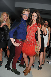 HENRY CONWAY and ROSANNA FALCONER at Diego Bivero-Volpe's 30th birthday party in aid of the charity Kids Company held at the Rook & Raven Gallery, 7 Rathbone Place, London W1 on 12th April 2013.