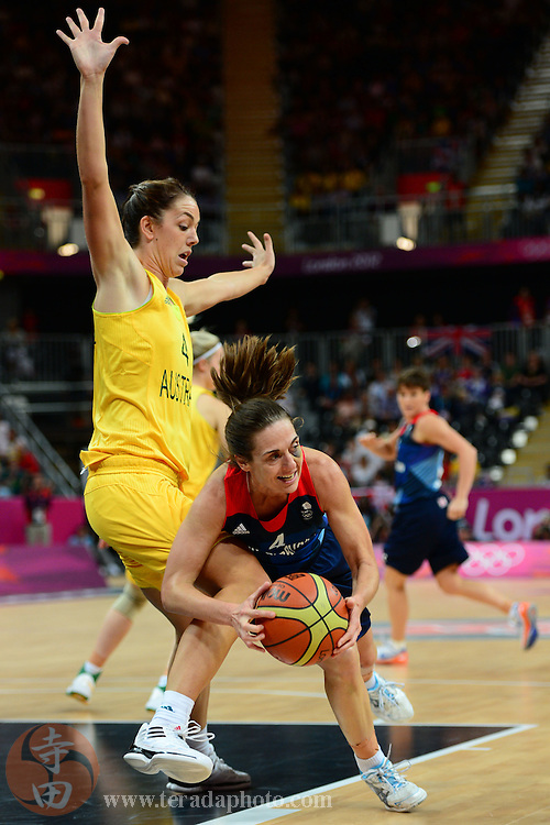 Jul 28, 2012; London, United Kingdom; Great Britain guard Natalie Stafford (4, right) falls in front of Australia guard Jenna O'Hea (4, left) during the first half at Basketball Arena.