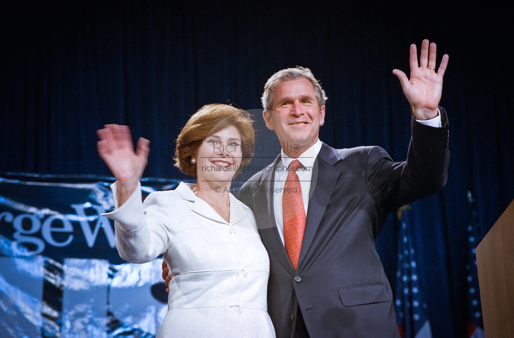 Texas Gov. George W. Bush and his wife Laura wave, during a campaign fundraising event June 22, 1999 in Washington, DC. Bush is the frontrunner for the Republican presidential nomination in the Year 2000.