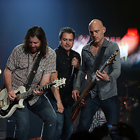 The Eli Young Band performs during the True Believers Tour concert at the CFE Arena on the University of Central Florida campus, on Thursday, April 24, 2014, in Orlando, Florida.  (AP Photo/Alex Menendez)