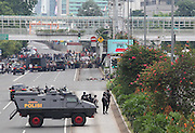 Jan. 14, 2016 - Jakarta, Jakarta, Indonesia -<br /> <br /> Indonesian police take position and aim their weapons as they pursue suspects after Jakarta blasts hit the Indonesia on January 14, 2016 in Jakarta, Indonesia. At least seven blasts were heard in Indonesia's capital Jakarata late Thursday morning leaving seven, including four attackers, dead<br /> . ©Exclusivepix Media