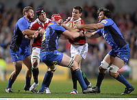 5 June 2013; Jonathan Sexton, British & Irish Lions, with support from Sean O'Brien is tackled by Phoenix Battye and Toby Lynn, right, Western Force. British & Irish Lions Tour 2013, Western Force v British & Irish Lions, Patterson's Stadium, Perth, Australia. Picture credit: Stephen McCarthy / SPORTSFILE