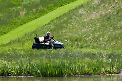 May 15, 2019 - Bethpage, New York, United States - John Daly uses a golf cart on the 8th hole during a practice round at the 101st PGA Championship at Bethpage Black. (Credit Image: © Debby Wong/ZUMA Wire)
