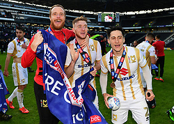 Ryan Watson of Milton Keynes Dons celebrates winning promotion to Sky Bet League One with George Williams of Milton Keynes Dons and Ryan Harley of Milton Keynes Dons   - Mandatory by-line: Joe Meredith/JMP - 04/05/2019 - FOOTBALL - Stadium MK - Milton Keynes, England - Milton Keynes Dons v Mansfield Town - Sky Bet League Two