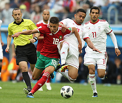 SAINT PETERSBURG, June 15, 2018  Morocco's Amine Harit (2nd L, front) vies with Iran's Omid Ebrahimi (2nd R) during a group B match between Morocco and Iran at the 2018 FIFA World Cup in Saint Petersburg, Russia, June 15, 2018. (Credit Image: © Lu Jinbo/Xinhua via ZUMA Wire)