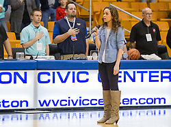 Woodrow Wilson's Maggie Cook sings the national anthem prior to the start of Wyoming East and Bluefield at the Charleston Civic Center.