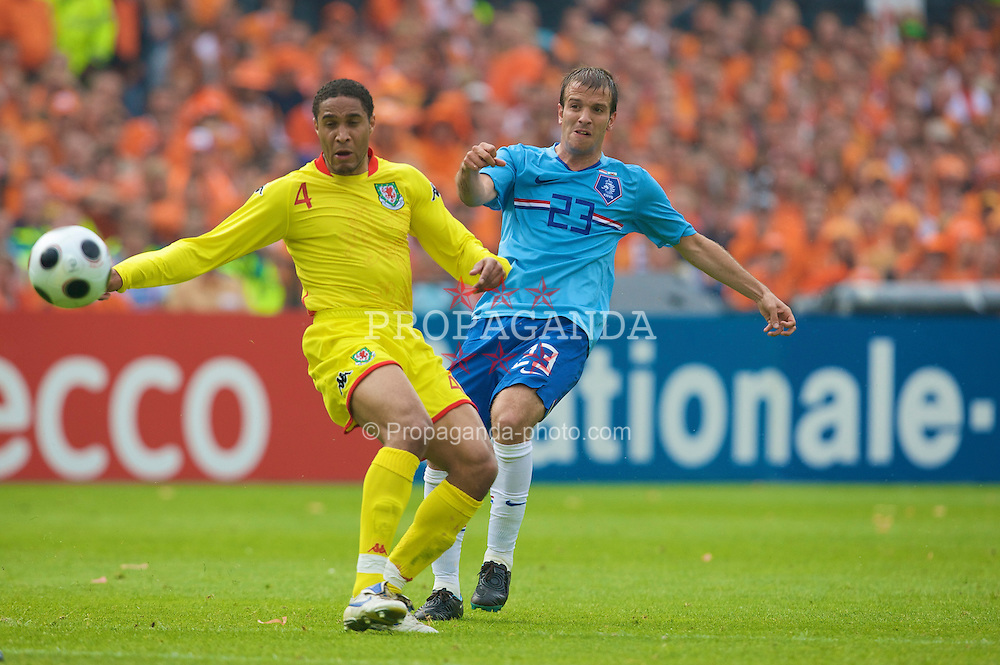 ROTTERDAM, THE NETHERLANDS - Sunday, June 1, 2008: Wales' Ashley Williams and the Netherlands' Rafael van der Vaart during the international friendly match at the de Kuip Stadium. (Photo by David Rawcliffe/Propaganda)