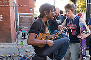 Musician busking for tips outside The Tabernacle in Atlanta Georgia on June 10, 2017Audience waiting to enter The Tabernacle concert venue in Atlanta, Georgia USA on June 20, 2017 for a performance of the Swedish Grammy winning heavy metal band Ghost