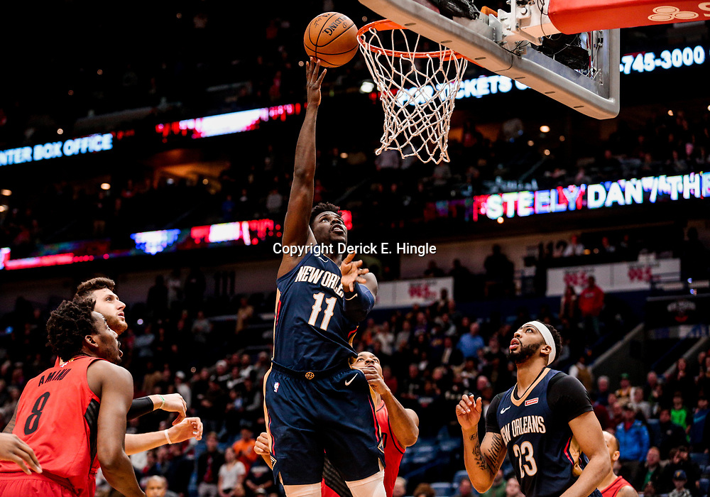 Jan 12, 2018; New Orleans, LA, USA; New Orleans Pelicans guard Jrue Holiday (11) shoots against the Portland Trail Blazers during the first quarter at the Smoothie King Center. Mandatory Credit: Derick E. Hingle-USA TODAY Sports