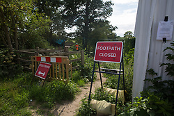 Harefield, UK. 13 July, 2020. A footpath closed to the general public due to ground clearance work for the HS2 high-speed rail project.
