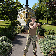 BANGOR Maine,  -- 8/8/15 - Builder 2nd Class Joshua Phillips of Gardiner, Maine poses at the USS Maine Memorial in downtown Bangor on Saturday. Phillips, and four fellow reservists from Navy Operational Support Center, Bangor, spent the afternoon spreading mulch around the memorial's pathways. USS Maine, (ACR-1) an armored cruiser commissioned in 1895, sank in Havana harbor in 1898, just prior to the Spanish-American War. (U.S. Navy Photo by Chief Mass Communication Specialist Roger S. Duncan/Released)