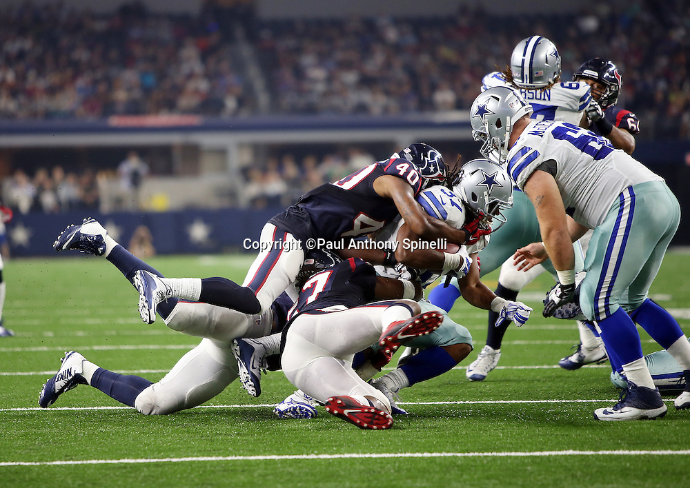 Houston Texans inside linebacker Justin Tuggle (57) and Houston Texans rookie free safety Kurtis Drummond (40) gang tackle Dallas Cowboys running back Gus Johnson (37) on a third quarter run during the 2015 NFL preseason football game against the Dallas Cowboys on Thursday, Sept. 3, 2015 in Arlington, Texas. The Cowboys won the game 21-14. (©Paul Anthony Spinelli)