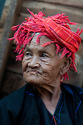 Myanmar. Older woman at Aungban weekly market wearing a head scarf.