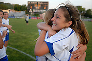 5 JUNE 2010 -- FENTON, Mo. -- Liberty High School's Taylor Schmidt (obscured, 20, left) hugs teammate Halsey Baldridge (5, right) in celebration after the Jays topped Pattonville in the Class 3 championship game at the MSHSAA girls' soccer tournament Saturday, June 5, 2010 at the Anheuser-Busch Center in Fenton, Mo. Photo (c) copyright 2010 by Sid Hastings.
