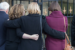 © Licensed to London News Pictures . 16/01/2014 . Salford , UK . Mourners hug as the cortege arrives . The funeral of Labour MP Paul Goggins at Salford Cathedral today (Thursday 16th January 2014) . The MP for Wythenshawe and Sale East died aged 60 on 7th January 2014 after collapsing whilst out running on 30th December 2013 . Photo credit : Joel Goodman/LNP