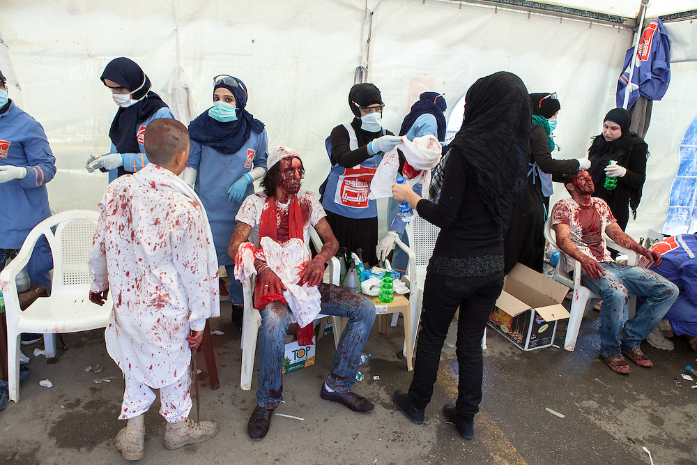 Shiite muslim men receiving medical attention in a tent after fainting due to excessive blood loss. Wounds were self-inflicted. Day of Ashura, Nabatieh, Lebanon (November 14, 2013).