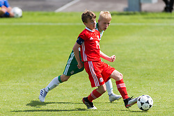WREXHAM, WALES - Thursday, August 15, 2019: Wales' Paige Wilding and Northern Ireland's Mitchell Watterson during the UEFA Under-15's Development Tournament match between Wales and Northern Ireland at Colliers Park. (Pic by Paul Greenwood/Propaganda)
