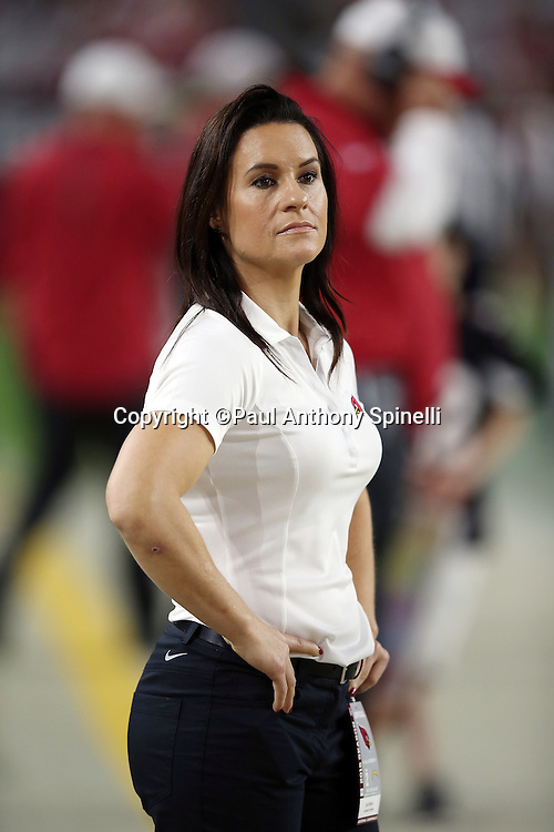 Arizona Cardinals Coach Jen Welter, the first female coach in the NFL, looks on from the sideline during the 2015 NFL preseason football game against the San Diego Chargers on Saturday, Aug. 22, 2015 in Glendale, Ariz. The Chargers won the game 22-19. (©Paul Anthony Spinelli)