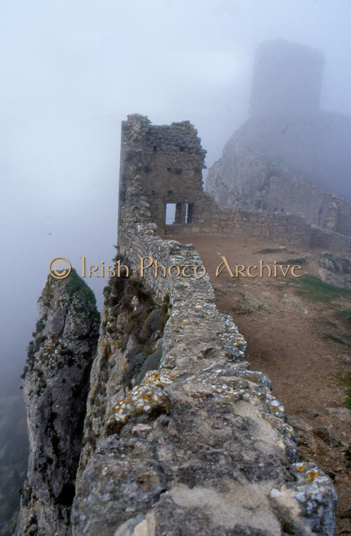 France, Languedoc and Roussillon.  Chateau de Peyrepertuse in the mist.