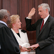 President Bush looks on as former Sen. John Danforth (R-MO) is sworn in as Bush's new ambassador to the United Nations (UN) by Supreme Court Justice Clarence Thomas Thursday, July 1, 2004, in the Eisenhower Executive Office Building.  Also in attendence is Sally Danforth, the ambassador's wife...Photo by Khue Bui
