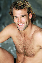 Portrait of a shirtless  man smiling
