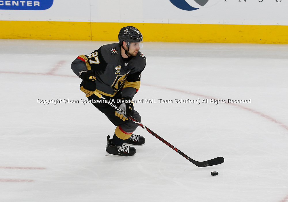 LAS VEGAS, NV - APRIL 11: Vegas Golden Knights defenseman Shea Theodore (27) moves the puck up the ice during Game One of the Western Conference First Round of the 2018 NHL Stanley Cup Playoffs between the L.A. Kings and the Vegas Golden Knights Wednesday, April 11, 2018, at T-Mobile Arena in Las Vegas, Nevada. (The Golden Knights won 1-0. (Photo by: Marc Sanchez/Icon Sportswire)