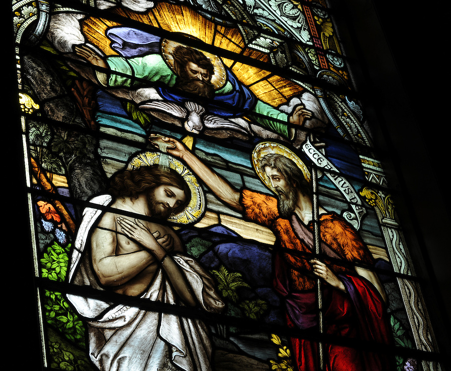 Stained glass window at Ss. Peter and Paul Church in Kiel, Wis., depicts Jesus' baptism by John the Baptist. (Sam Lucero photo)