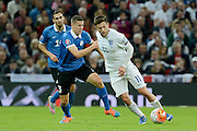 England midfielder Adam Lallana turns Artur Pikk during the Group E UEFA European 2016 Qualifier match between England and Estonia at Wembley Stadium, London, England on 9 October 2015. Photo by Alan Franklin.