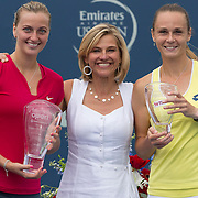 August 23, 2014, New Haven, CT:<br /> Tournament Director Anne Worcester poses for a photograph with champion Petra Kvitova and finalist Magdalena Rybarikova during a ceremony following the Singles Final on day nine of the 2014 Connecticut Open at the Yale University Tennis Center in New Haven, Connecticut Saturday, August 23, 2014.<br /> (Photo by Billie Weiss/Connecticut Open)