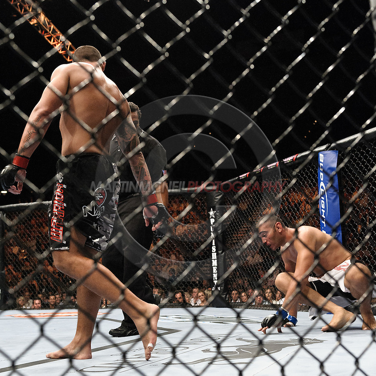 "LAS VEGAS, NEVADA, MAY 24, 2008: Thiago Silva (left) walks away from a downed Antonio Mendes during ""UFC 84: Ill Will"" inside the MGM Grand Garden Arena in Las Vegas"